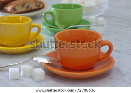 Waiting for Morning Coffee with Chocolate Chip Biscotti. Shallow DOF. - stock photo