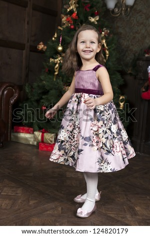 waiting for Santa Claus. Happy little girl near Christmas tree