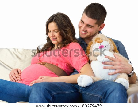 Waiting for the baby / Young pregnant women with her husband - stock photo