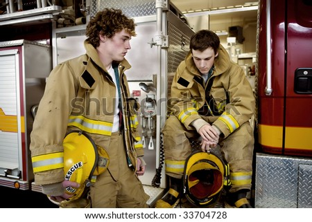 Waiting for the debriefing after a large fire. - stock photo