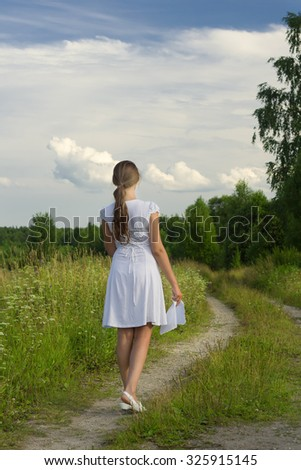Waiting. Girl in retro dress at wheat field - stock photo