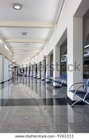 Waiting hall of a modern airport - stock photo