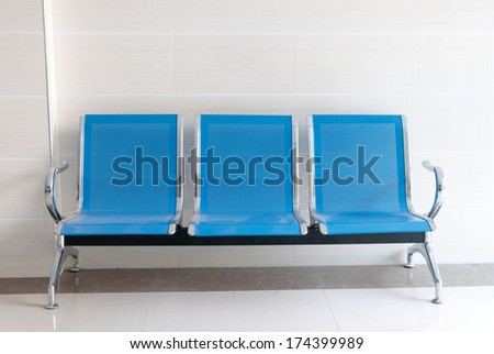 waiting room blue chairs - stock photo