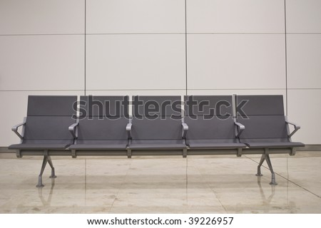 Waiting room - chairs against a grey wall - stock photo