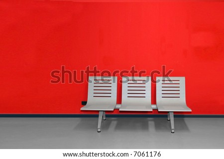 Waiting room - chairs against a red wall - stock photo