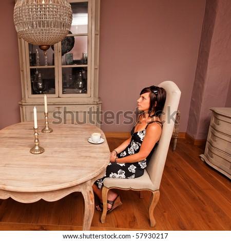 waiting room - girl with coffee waiting - stock photo