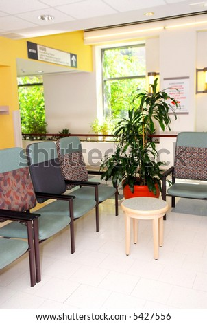 Waiting room in a hospital or clinic with empty chairs - stock photo