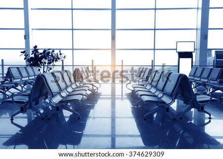 Waiting room with eight chairs, place in airport, blue tone - stock photo