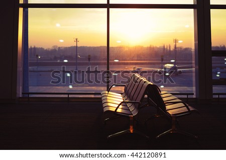 Waiting Room With Seats In Airport At Sunrise - stock photo