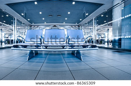 waiting spacious room with blue wide seats inside cool airport - stock photo