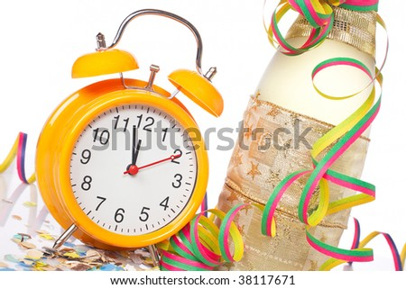 Waiting the New Year with champagne bottle and clock. Shallow depth of field