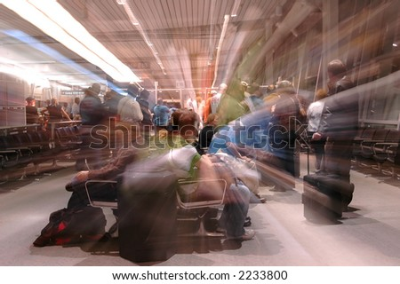 Waiting to board the plane at the departure gate - stock photo