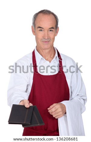 Waitor giving menus - stock photo