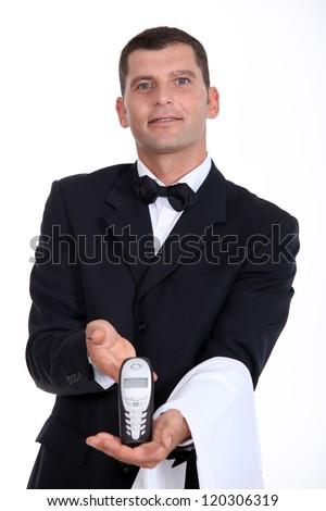 Waitor giving phone - stock photo