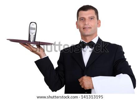 Waitor serving telephone - stock photo