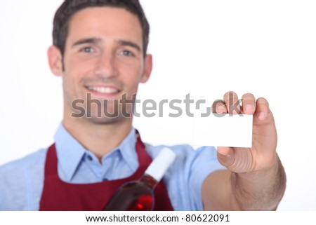 Waitor showing businesscard - stock photo