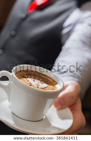 waitre serving coffee cup close - stock photo