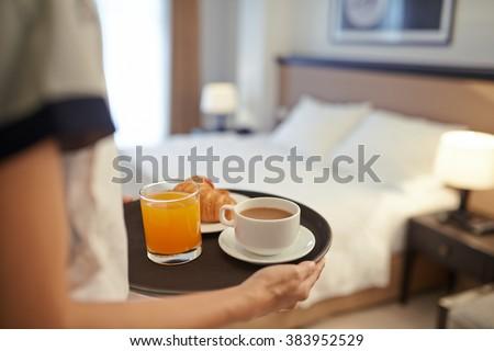 Waitress bringing breakfast to the hotel room - stock photo