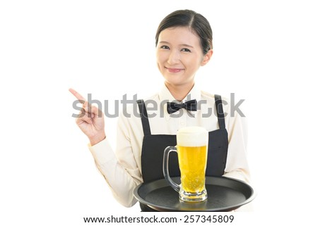 Waitress carrying beer - stock photo