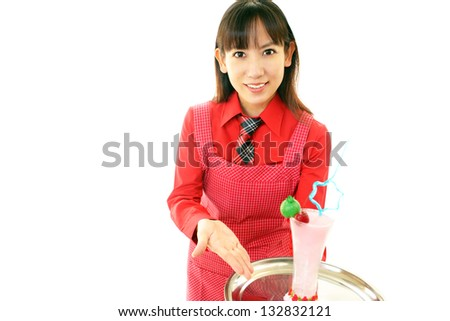Waitress delivering drink to table