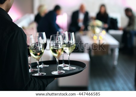 Waitress distributes wine for the wedding guests - stock photo
