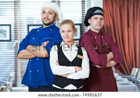 Waitress girl administrator and chefs of commercial restaurant in uniform