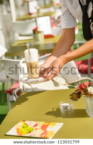 Waitress hands close up serving latte cafe bar terrace sunny - stock photo