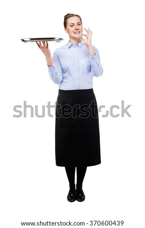 Waitress holding tray isolated over white background. Smiling. Whole person. - stock photo