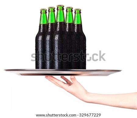 Waitress holding tray with bottles of beer isolated on white background - stock photo