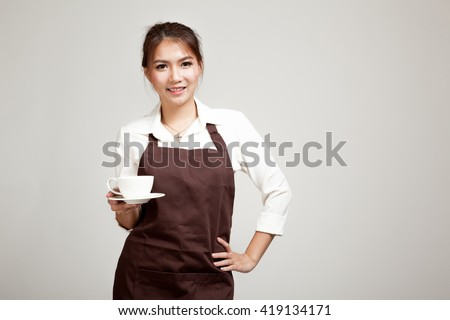 Waitress or barista  in apron  holding coffee