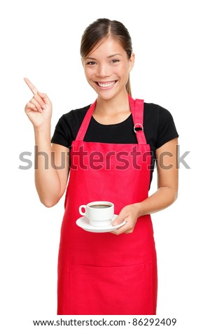 Waitress or barista pointing holding coffee. Woman in apron smiling happy isolated on white background. - stock photo