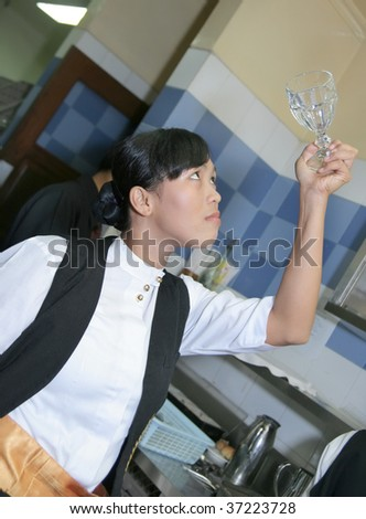 waitress polishing glass