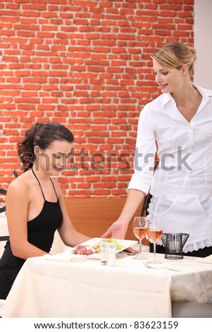 Waitress serving a meal - stock photo