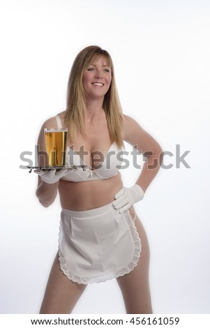 WAITRESS SERVING BEER FROM A TRAY - CIRCA 2016 - A scantily dressed waitress holding a silver tray and a glass of beer