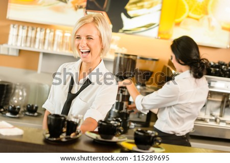 Waitress serving coffee cups making espresso woman cafe bar working - stock photo