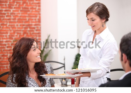 Waitress serving customers