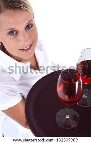 Waitress serving two glasses of wine - stock photo