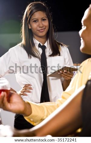 Waitress taking a customer's order - stock photo