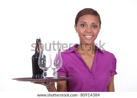 Waitress with beer tray - stock photo