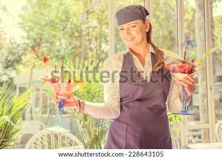waitress with two cups of ice cream. concept about occupation and profession - stock photo