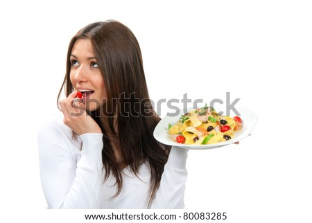 Waitress woman holding plate with italian pasta, pappardelle, tagliatelle, macaroni, spaghetti with  shrimps and olives and tasting one small tomato on a white background