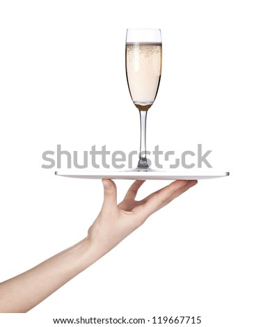 Waitresses hand holding a silver serving tray with champagne. isolated - stock photo
