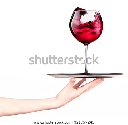 Waitresses holding tray with glass of red wine isolated on a white background - stock photo