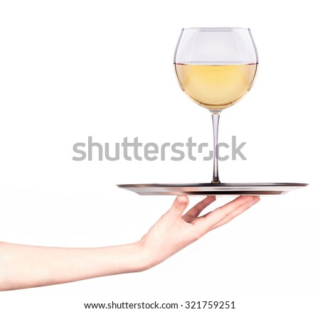 Waitresses holding tray with glass of white wine isolated on a white background - stock photo