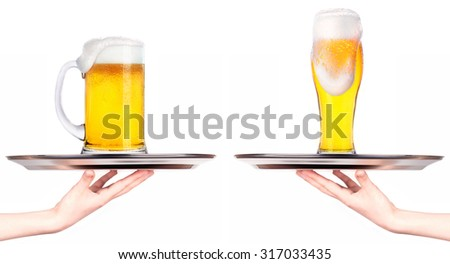 Waitresses holding tray with light beer isoalted on white background - stock photo