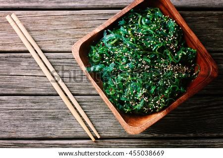 Wakame salad with chopsticks - stock photo