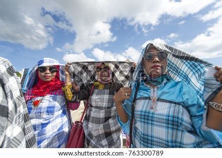 Wakatobi, Indonesia-Nov 11, 2017:Buton women parade and perform dance with colourful traditional costumes during Wakatobi Wave Festival. This is an annual ethnic event in Southeast Sulawesi.