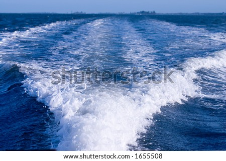 Wake behind boat underway - stock photo