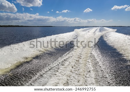 Wake behind boat underway, Cape Coral - stock photo
