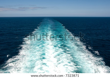 Wake caused by cruise ship. - stock photo